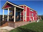 View larger image of Big rig in front of fall foliage at TRAVERSE BAY RV RESORT image #3