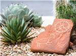 View larger image of A red rock with some native drawing on them at DISTANT DRUMS RV RESORT image #3