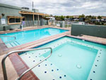 View larger image of Swimming pool with hot tub at DISTANT DRUMS RV RESORT image #11
