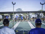 View larger image of A group of men playing shuffleboard at HILLCREST RV RESORT image #4