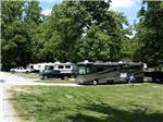 View larger image of RVs and trailers at campgrounds with black truck at THREE SPRINGS CAMPGROUND image #1