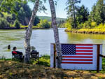 View larger image of Couple sitting by the river at HOQUIAM RIVER RV PARK image #9
