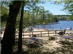 View larger image of Picnic tables near the beach at MEREDITH WOODS 4 SEASON CAMPING AREA image #6