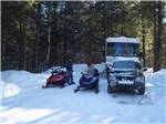 View larger image of Campers at the lake at MEREDITH WOODS 4 SEASON CAMPING AREA image #9