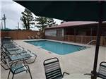 View larger image of Sign at the park entrance at WILD FRONTIER RV RESORT image #3