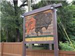 View larger image of Flower bed with RVs in background at WILD FRONTIER RV RESORT image #6