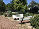 View larger image of Two park benches facing each other at MOUNTAIN HOME RV RESORT image #10