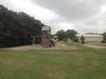 View larger image of Playground with swing set at PRAIRIE VIEW RV PARK  CAMPGROUND image #8