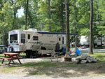 View larger image of RV with awning at DEER RUN CAMPING RESORT image #1