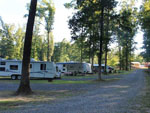 View larger image of Gravel road leading into RV park at DEER RUN CAMPING RESORT image #3