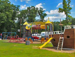 View larger image of Playground with swing set at DEER RUN CAMPING RESORT image #9
