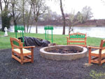 View larger image of Fire pit on the lake at ELKTON RV PARK image #3