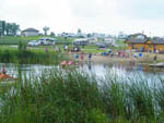 View larger image of Trailers camping on the water at LAZY ACRES RV PARK image #5