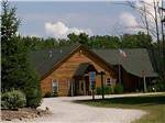 View larger image of A fifth wheel trailer parked in an RV site at AMERICAN WILDERNESS CAMPGROUND image #1