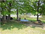 View larger image of Waterfront site with picnic table at AMERICAN WILDERNESS CAMPGROUND image #8