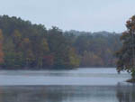 View larger image of Beautiful fall colored trees surrounding large lake at DEER RUN RV RESORT image #9