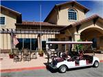 View larger image of Six person golf cart out front of main office at COYOTE VALLEY RV RESORT image #5