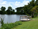 View larger image of Lake view with wood platform at KOC KAMPGROUND image #6