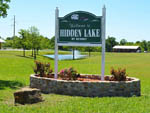 View larger image of Sign at entrance to RV park at HIDDEN LAKE RV RESORT image #5