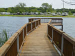 View larger image of Pier on the lake at HIDDEN LAKE RV RESORT image #6