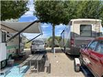 View larger image of A couple of RVs with a picnic bench at TWIN PINES RV PARK  CAMPGROUND image #5
