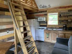 View larger image of Bunk beds and kitchen in a cabin at KLONDIKE RV PARK  CABINS image #5