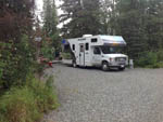 View larger image of RV parked in a gravel site at KLONDIKE RV PARK  CABINS image #6