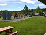 View larger image of Playground with swing set at BOW RIVERSEDGE CAMPGROUND image #9