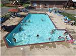View larger image of People swimming in pool at MEMPHIS JELLYSTONE CAMP RESORT image #9