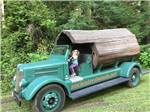 View larger image of A small girl driving a truck at ANCIENT REDWOODS RV PARK image #8
