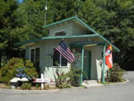 View larger image of Office with an American flag and Good Sam flag in front at BROOKINGS RV PARK image #5