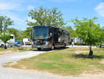 View larger image of RV parked at campsite at BENNETTS RV RANCH image #12