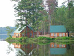 View larger image of Cabins on the lake with green pine trees at YOGI ON THE LAKE image #5