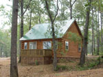 View larger image of Log cabin with green roof at YOGI ON THE LAKE image #7