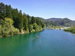 View larger image of River and hills with pine trees at RAMBLIN REDWOODS CAMPGROUND image #5