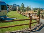 View larger image of Wooden fence running alongside well groomed grassy lawns at JACKSON RANCHERIA RV PARK image #8