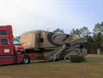 View larger image of Big rig towing large 5th wheel and carrying a Smart Car at AZALEA ACRES RV PARK image #4