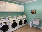 View larger image of Laundry room with washer and dryers at AZALEA ACRES RV PARK image #5