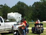 View larger image of Couples on cruising bikes near wide-open RV sites at AZALEA ACRES RV PARK image #8