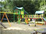 View larger image of Multi-colored play structures and slides in the sandy playground at FRIENDLY BEAVER CAMPGROUND image #3