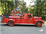 View larger image of Kids in old firetruck at FRIENDLY BEAVER CAMPGROUND image #11
