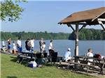 View larger image of Campers fishing at OAK HOLLOW FAMILY CAMPGROUND image #5