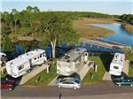 View larger image of Aerial view of RV sites walking bridge and bay at AVALON LANDING RV PARK image #4
