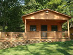 View larger image of Cabin with deck at WOODS TALL TIMBER RESORT image #4