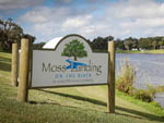 View larger image of The front entrance sign by the water at MOSS LANDING RV RESORT image #1