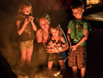 View larger image of Kids roasting marshmallows at PINEWOOD LODGE CAMPGROUND image #3