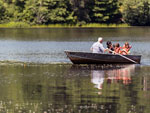 View larger image of Family boating at PINEWOOD LODGE CAMPGROUND image #4