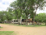 View larger image of RVs and trailers at campground at DAKOTA SUNSETS RV PARK  CAMPGROUND image #4