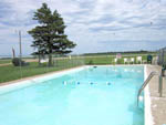 View larger image of Swimming pool at campground at DAKOTA SUNSETS RV PARK  CAMPGROUND image #5