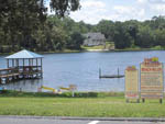 View larger image of The lake with the beach rules sign at LAKE WALDENA RESORT image #8
